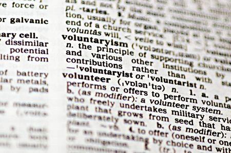 The word volunteer written in a thesaurus  Stock Photo