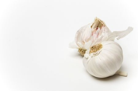 Two bulbs of garlic shot against a white background Stock Photo