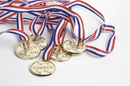 Gold medals shot against a white background symbolizing success