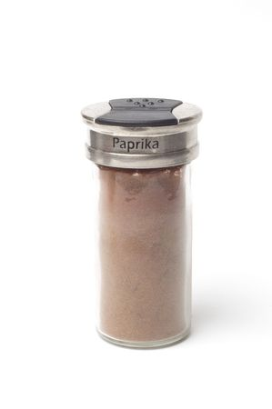 A jar of Paprika isolated on a white backgorund