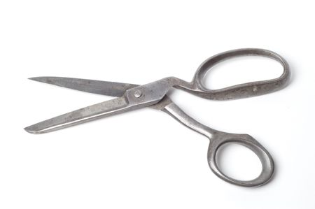 A pair of old scissors isolated on a black background Stock Photo