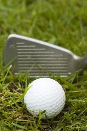 A golf ball waiting to be hit hard with a 3 iron Stock Photo