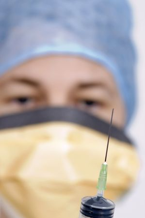 A shot of a syringe being held by a female medical practioner