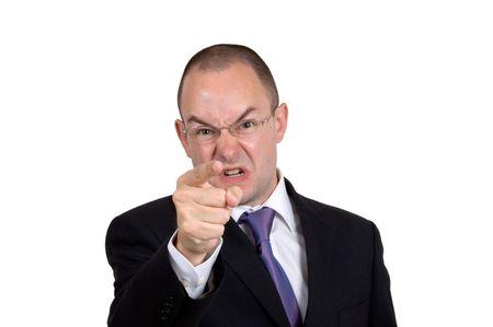 empresario enojado: Puntos enojados y gritos de un hombre de negocios Foto de archivo
