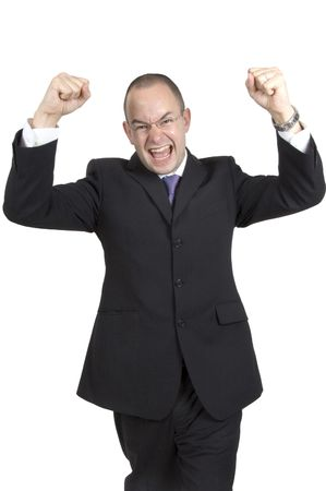 A businessman punches the air in delight and cheers Stock Photo