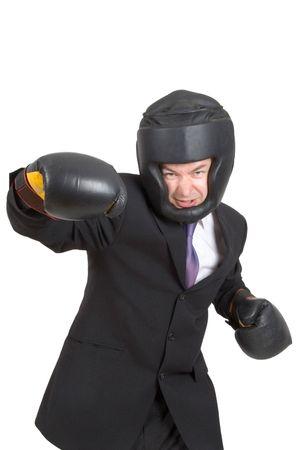 clash: Un hombre de negocios usando artes de boxeo aislados en blanco  Foto de archivo