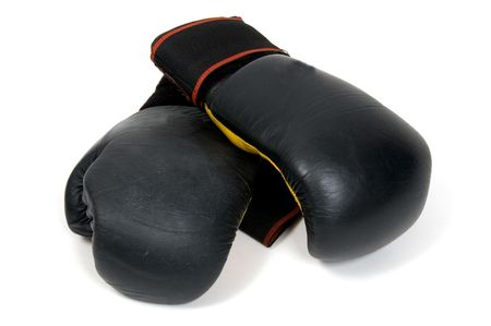 A pair of black boxing gloves shot against a white background