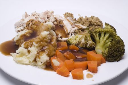 A roast dinner with chicken,carrots,brocolli and sage and onion stuffing