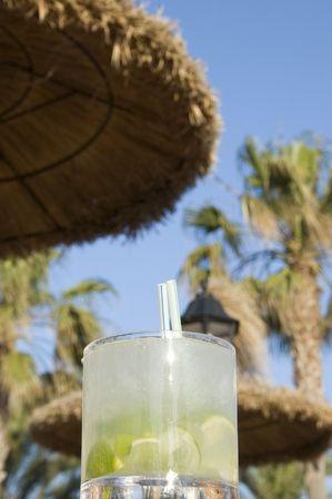 Caipirinha cocktail with holiday surroundings