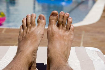 A pair of feet relaxing on holiday  Stock Photo