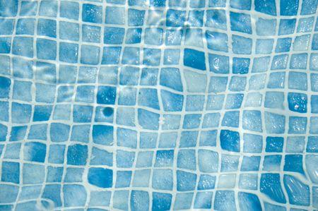 Closeup of blue swimming pool tiles
