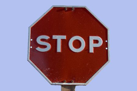 A stop sign shot against a blue background
