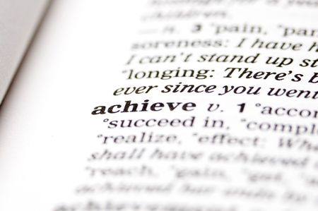 realize: The word achieve written in thesaurus Stock Photo