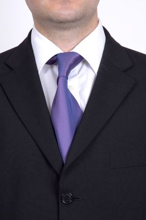 A closeup of a businessman wearing a suit and tie