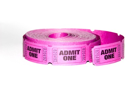 admit one: A roll of admit one tickets on a white background  Stock Photo