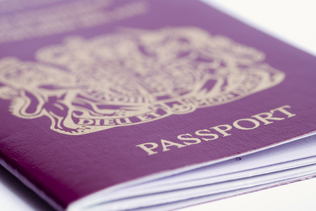A closeup shot of a passport on a white background