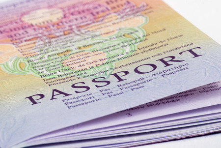oversea: A closeup shot of a passport on a white background