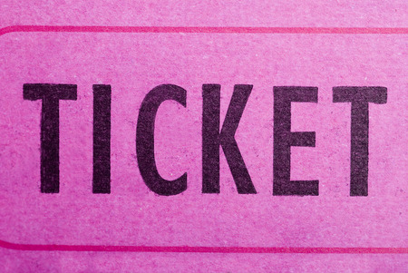 An entrance ticket in closeup on a white background