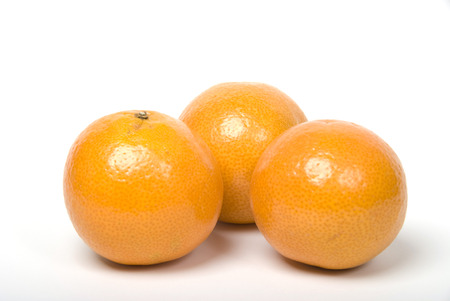 Three oranges isolated on a white backgorund Stock Photo