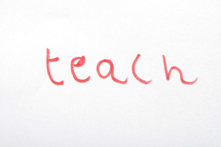The word teach written by a young child