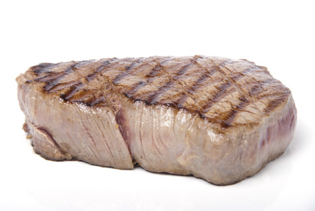 A piece of lovely fillet steak shot against a white background