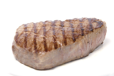 A lovely piece of juicy fillet steak shot against a white background Stock Photo