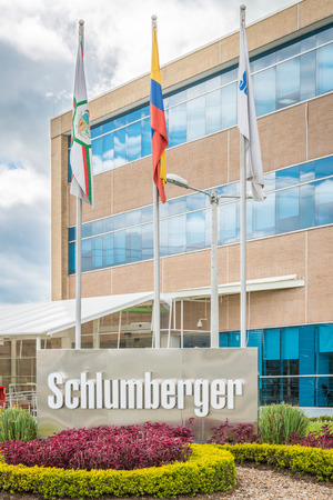 flagpoles: Cota, Colombia - June 2015 - Schlumberger outdoor sign with flagpoles