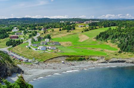 Folks enjoying good weather outdoors on a public beach, Middle Cove, Newfoundland, Canada