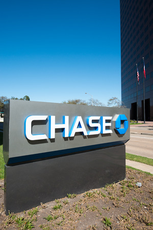 HOUSTON, TEXAS - FEBRUARY 2016: JPMorgan Chase Bank stand with the company logo outside of office on February 2016 in Houston, United States. JPMorgan Chase Bank is the largest bank in the United States, and the worlds sixth largest bank by total assets.
