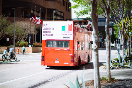 houston flag: HOUSTON, TEXAS - March 2016: Street scene in Houston Downtown with bouble deck red bus on sunny day on March 2016 in Houston, United States. Buy authentic Itallian add on the bus.