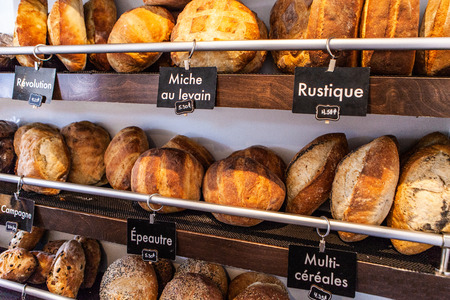 French bakery display with different kinds of bread loaves
