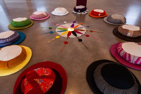 A closeup view on the 12 colors of the Native American-Indian symbolic color wheel, laid around a compass inside a worship room, believed to bring good health. Imagens
