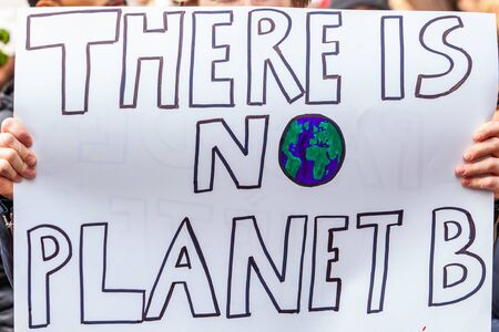 A home made placard is viewed close up, reading there is no planet b, as environmentalists stage a city demonstration against global warming