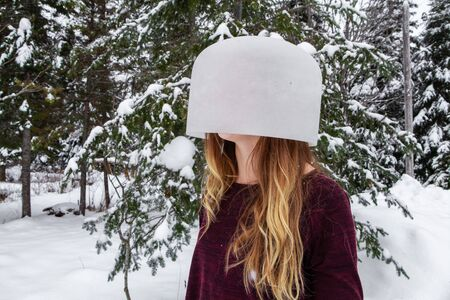 Girl with long hairs has a reversed crystal bowl on her head as a pseudo spiritual guru