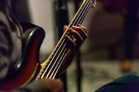 Closeup angle with blurry background. Musician is playing in a bar Standard-Bild - 133253916