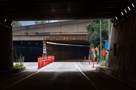 Caution, warning traffic cones at the tunnel exit of the highway. Engineering construction for underground car and truck transportation.