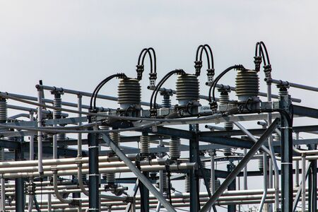 high voltage electrical substation tower top, close up on a closed electrical Isolator or Electrical Isolation Switch, Elements of a substation