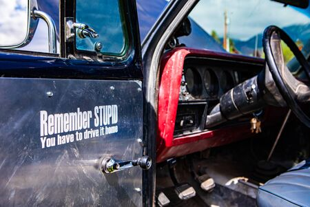 antique old car with a quote on the open door, remember stupid you have to drive it home, dusty style interior, Dashboard, steering wheel