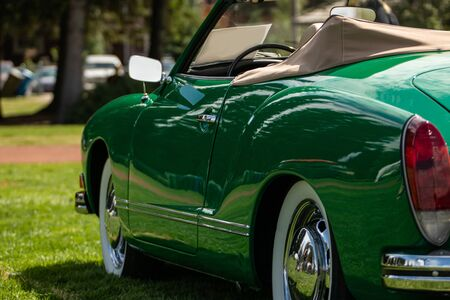 classic antique American green Convertible car side view from the back selective focus, with open roof and chrome wheels, during outdoor old cars show Zdjęcie Seryjne