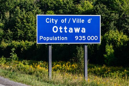 Ottawa city entrance Information Road blue Sign on the roadside, Canadian two languages French and English signs, Ville dottawa, Canada