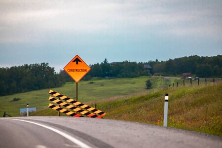 Temporary condition road signs, Construction work ahead with Barriers. on Canadian rural country highway roadside, warning orange symbols Reklamní fotografie