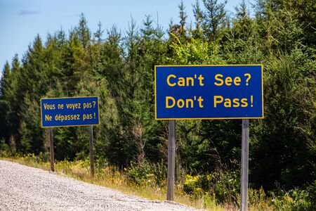 French and English Information road blue signs, You cannot see, do not overtake, Canadian rural country roadside, Ontario, Canada