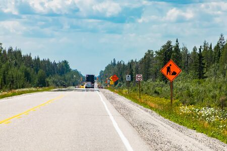 Temporary condition road warning signs on roadside before road work zones, diversions, detours, lane closures or traffic control people on the road