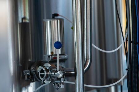 beer quality control equipment, pressure monitoring and sampling unit apposed to the side of a tank or vessel