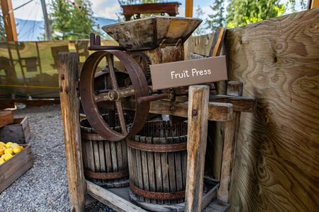 An old fruit pressing machine. A vintage machine used in the past for pressing grapes in the winery. Agricultural relics in the Museum
