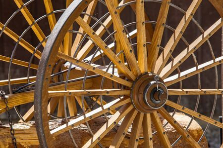 Old wagon wheels in the agriculture museum in Kootenays, British Columbia, Canada. Vintage rustic wooden wheels used in the past century