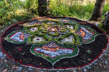 Natural art in the forest during a multicultural festival celebrating tradition and earth. Natural offerings for peace, prosperity and spirituality
