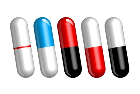 set of color pills or capsules on white