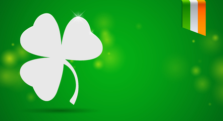 St. Patrick's day banner with white clover and irish flag ribbon on green background. Horizontal web banner with copy space Vectores