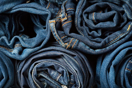 bluejeans: Stack of blue jeans as a background or texture Stock Photo